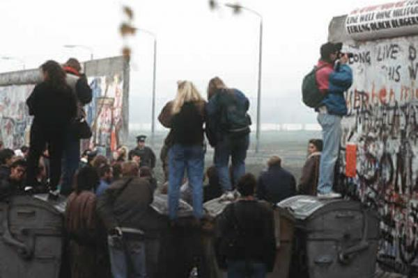 Berlin wall coming down image
